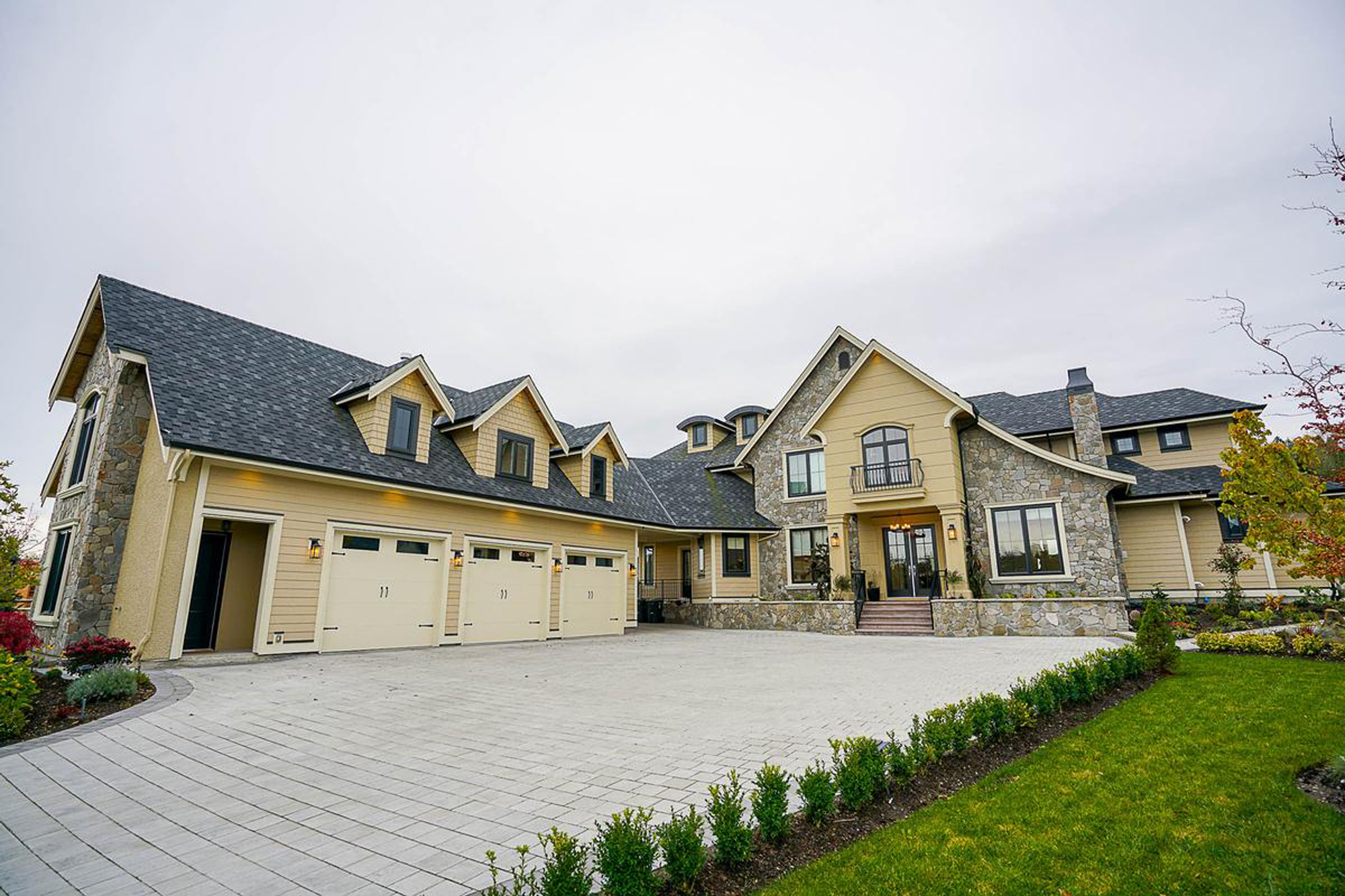 monmouth county Nj mansion stucco and stone exterior yellow stucco Gambrick custom home builder