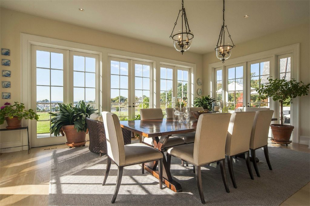 sunroom renovation glass wall dining room home builder jersey shore