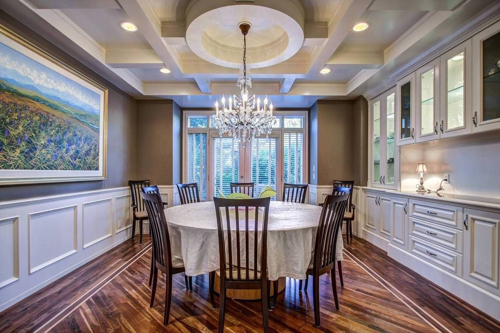 custom home builder gambrick round coffered ceiling wainscoting built ins dining room