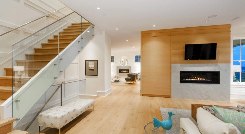 modern home design open staircase with glass railings Gambrick Custom Home Builders NJ