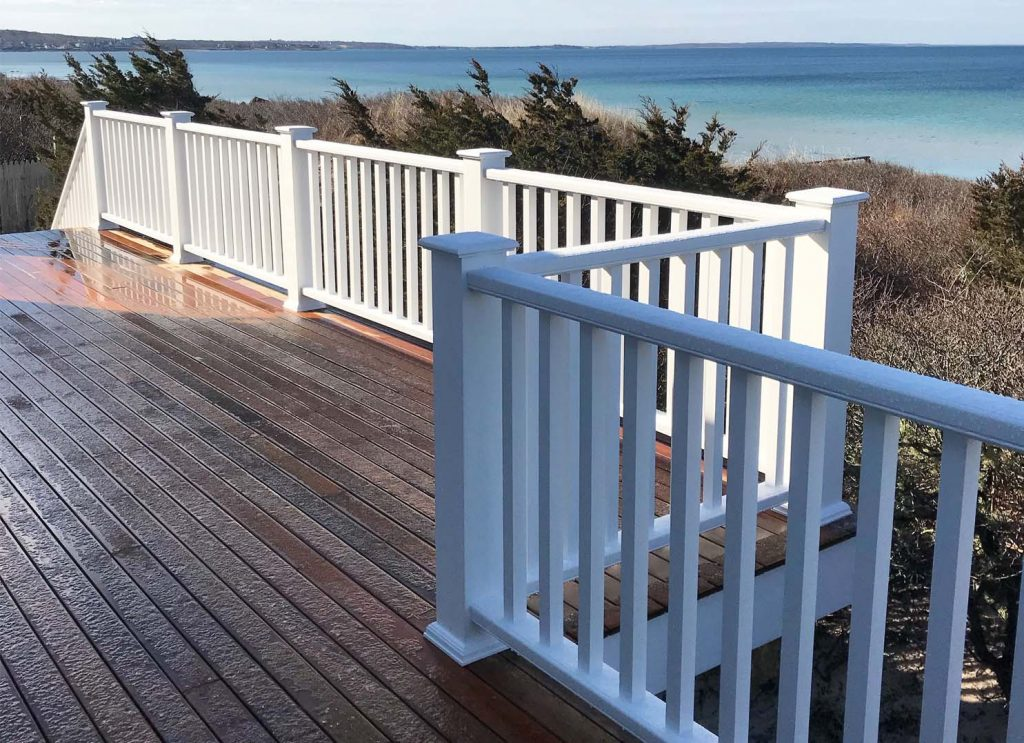top Trex deck builder NJ wood deck with white rails at the Jersey Shore