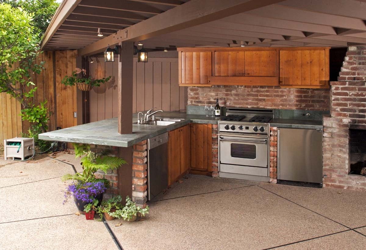 covered outdoor kitchen design stainless steel appliances and grill red brick and granite
