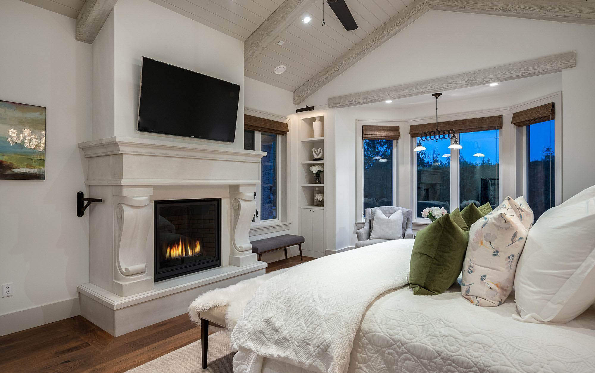 light master bedroom design with vaulted ceiling and a chalky gray color scheme