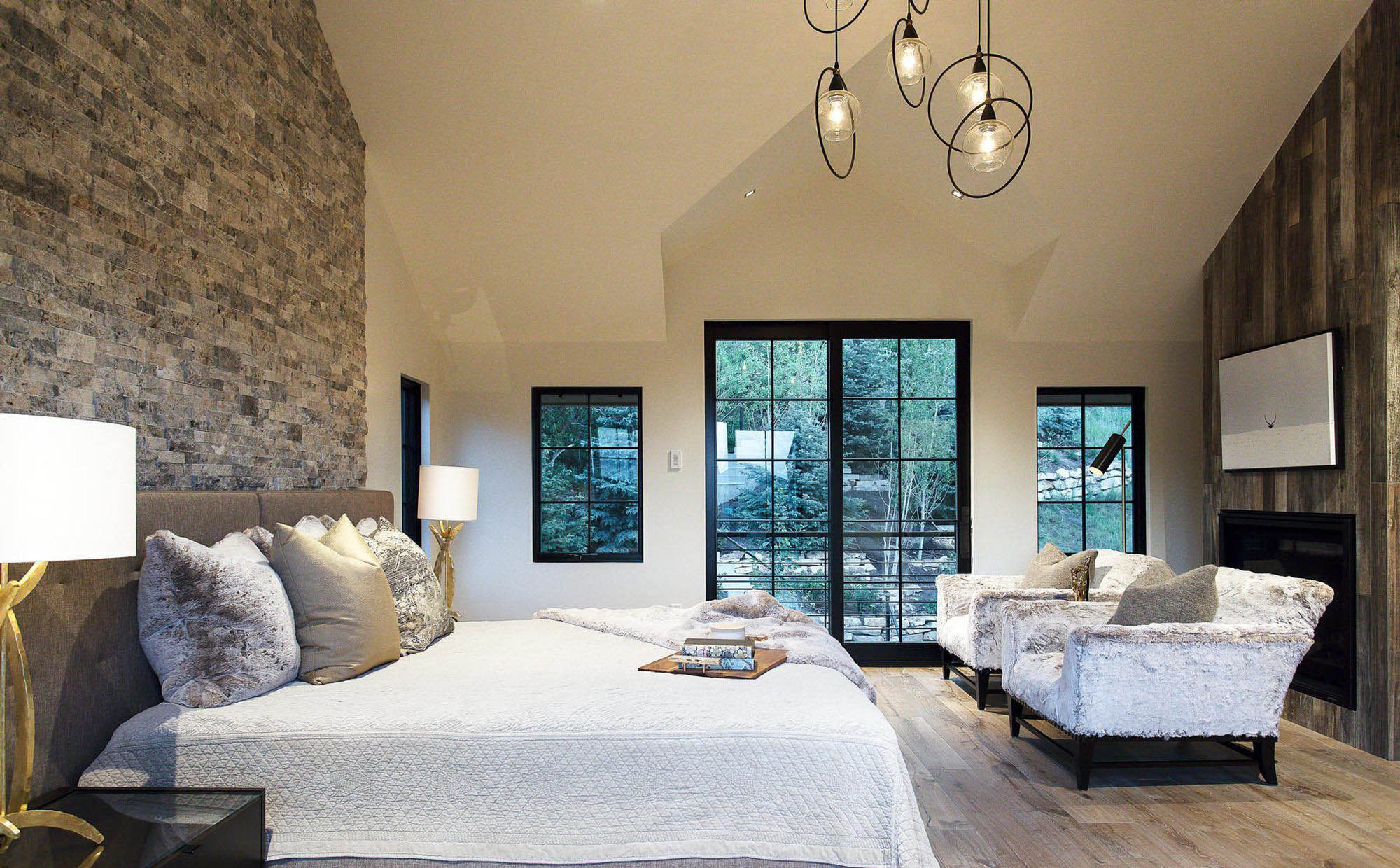 master bedroom design with two accent walls stone veneer and reclaimed wood paneling