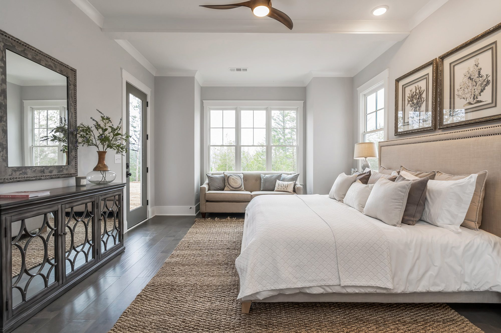 neutral colored master bedroom design cream and white dark hardwood floors area rug