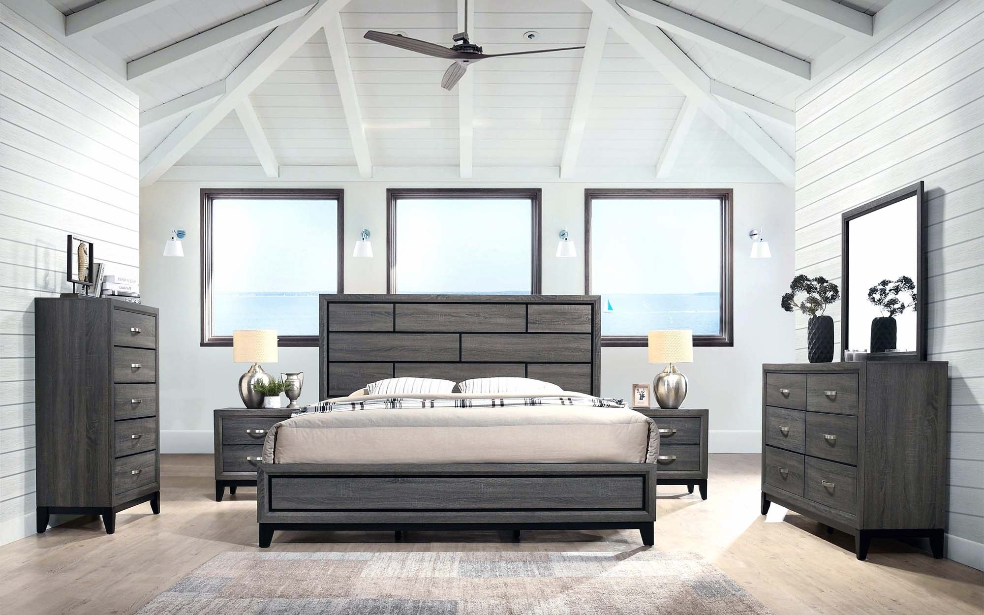 master bedroom with shiplap walls white vaulted ceiling exposed beams dark gray furniture