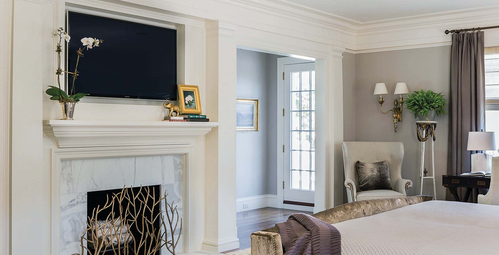 clean master bedroom with marble fireplace gray walls and thick whitetrim crown molding