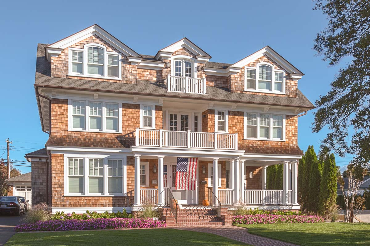 what color siding goes with red brick? cedar shake siding with red brick Gambrick Luxury Home Builder NJ