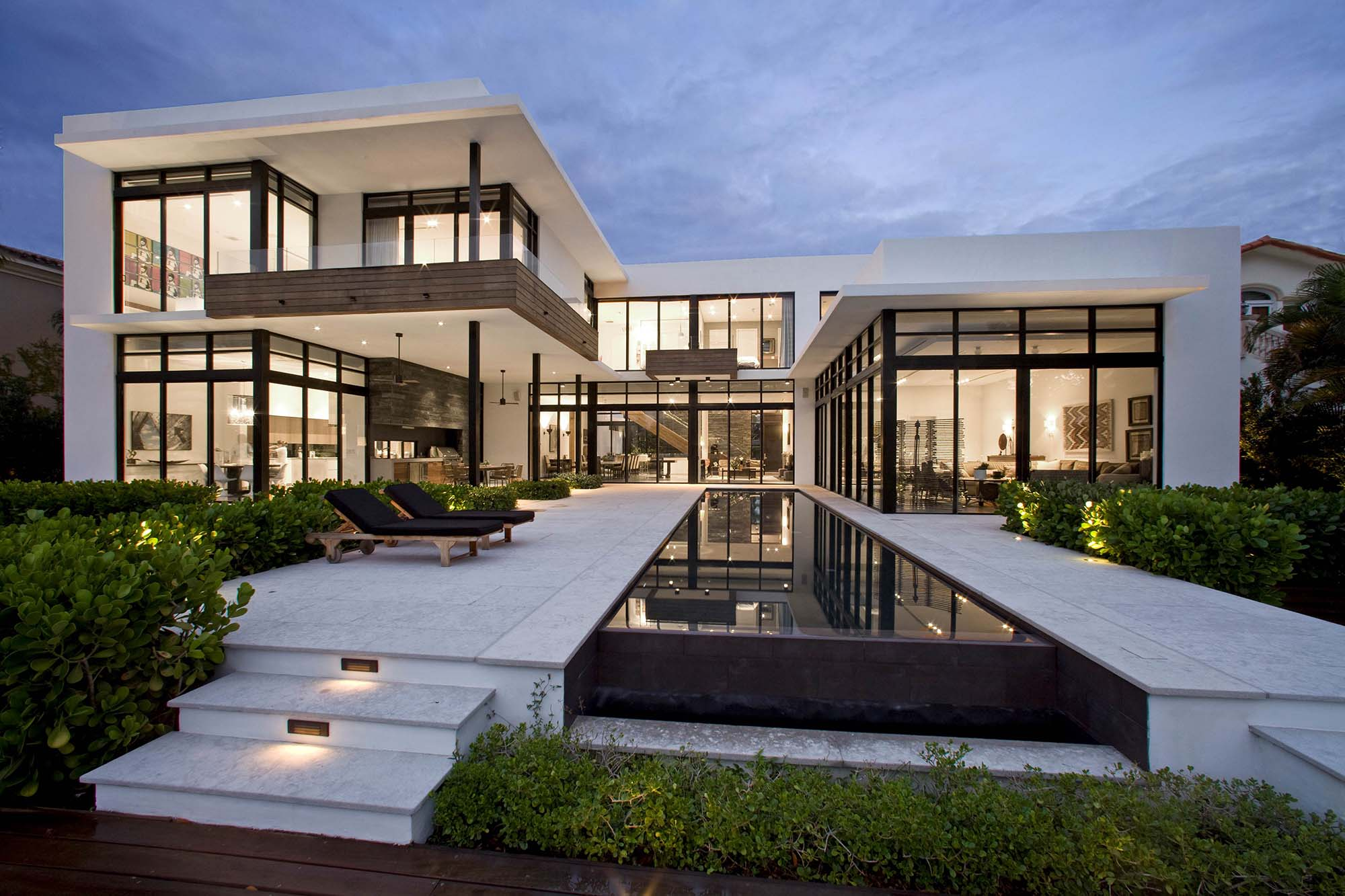 contemporary home tons of windows, balcony, flat roof, rectangle pool - Gambrick