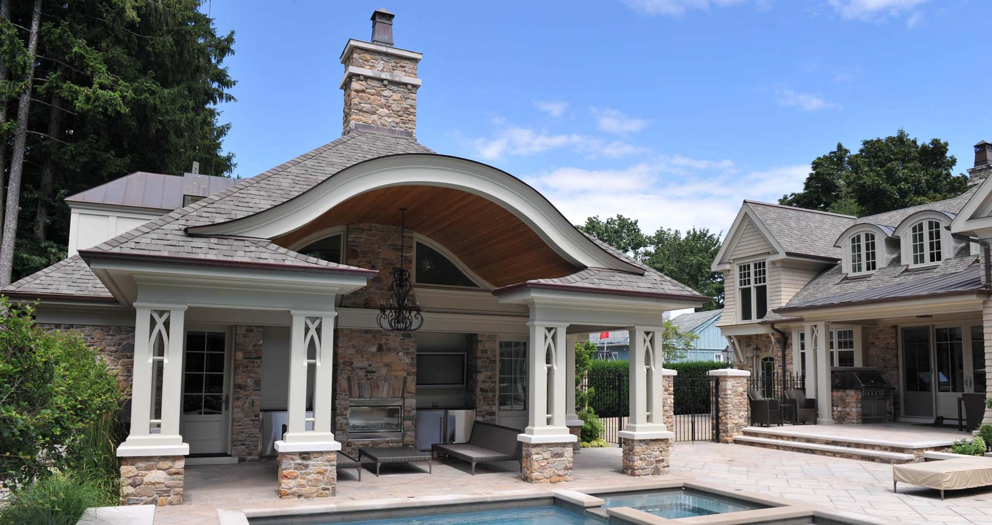 best pool house designs beautiful stone fireplace , arches and columns - Gambrick