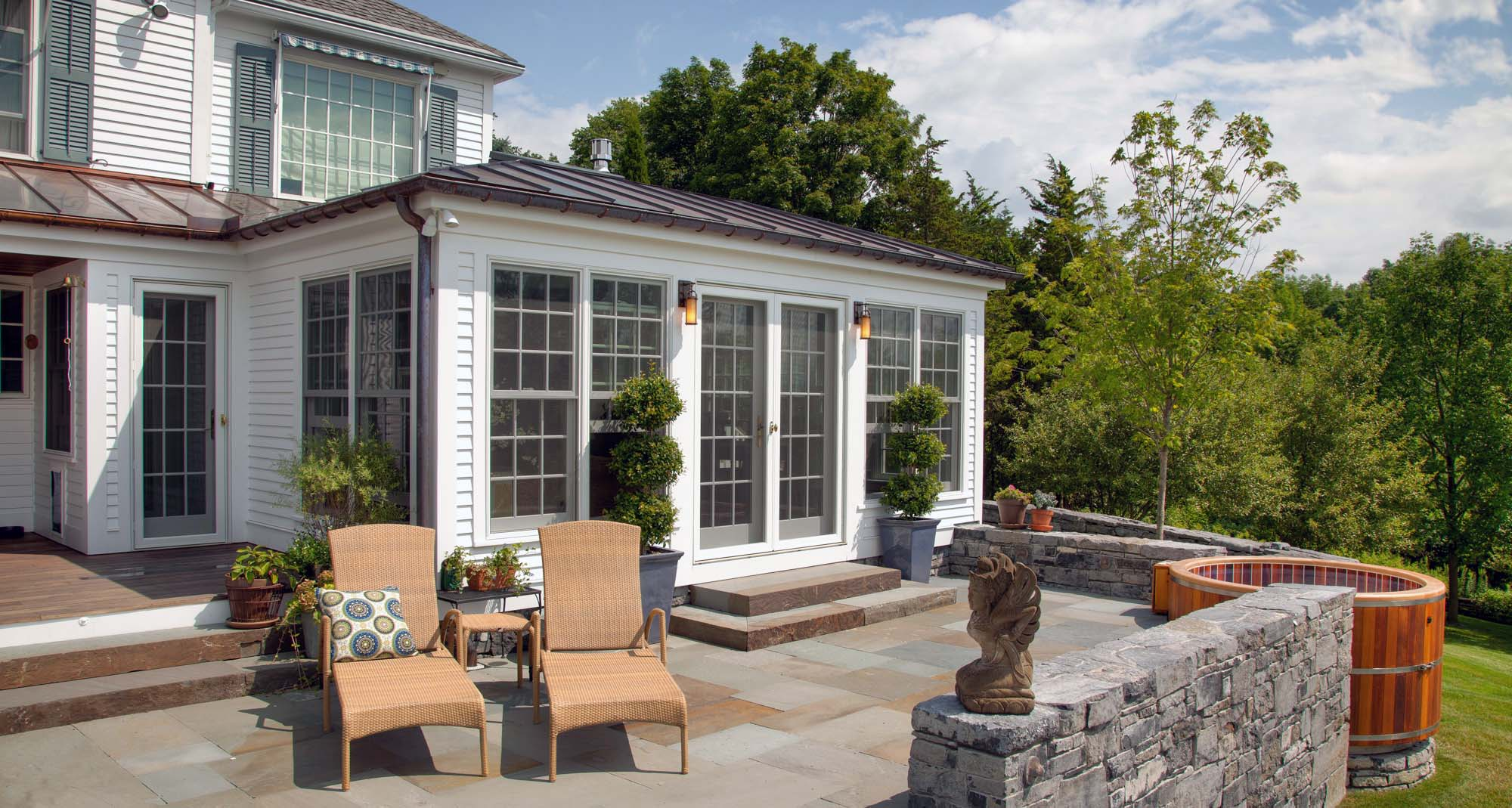 Top Local Long Branch NJ Sunroom Builder Exterior view beautiful sunroom and patio - Gambrick