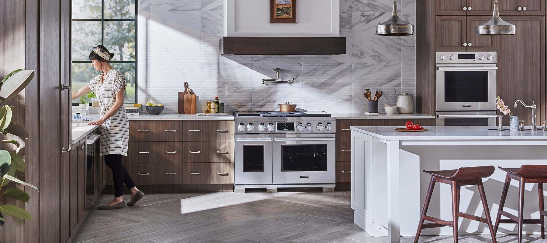 luxury kitchen design with marble backsplash and countertops wood cabinets