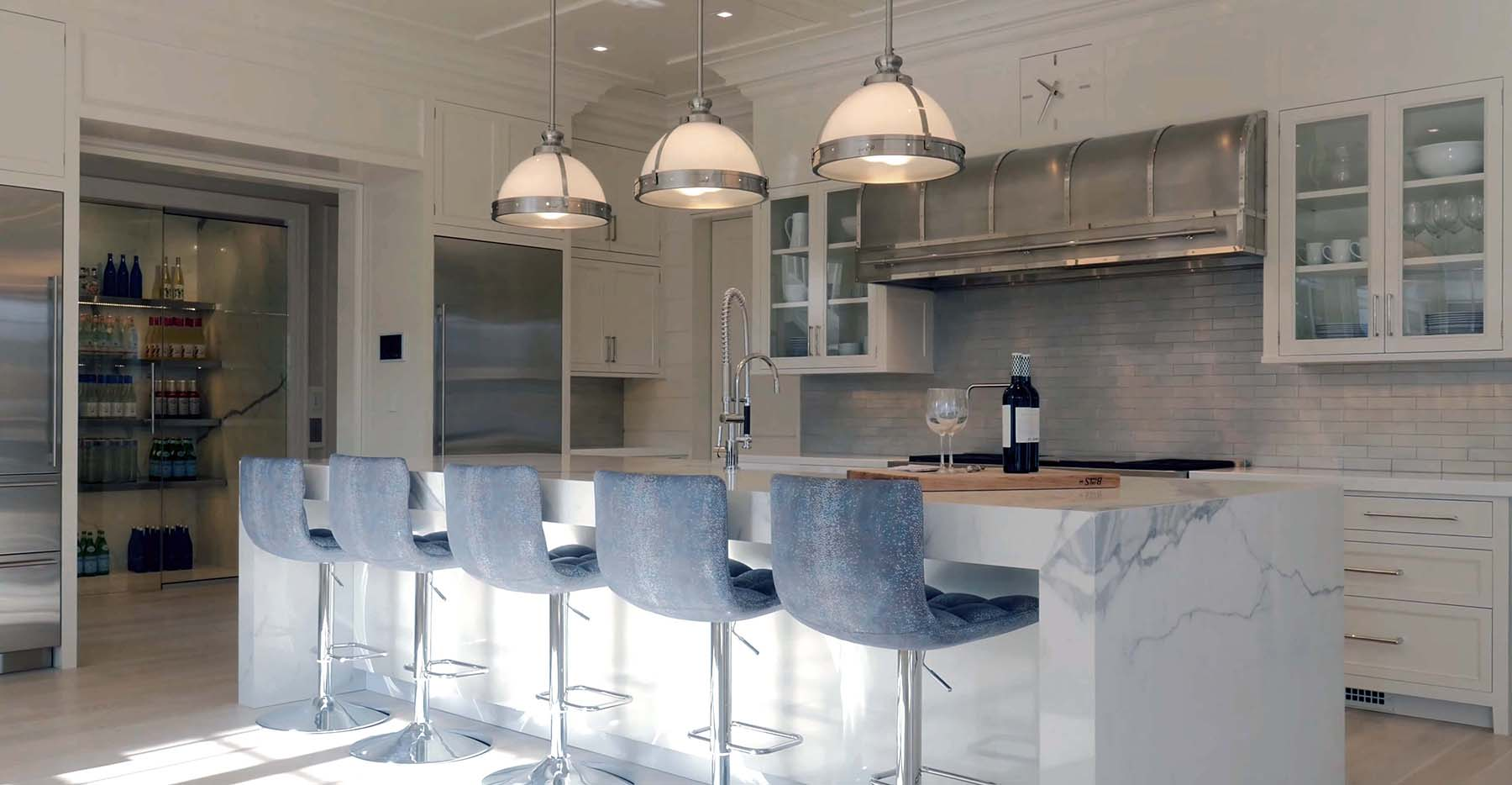 marble luxury NY kitchen with industrial stove hood