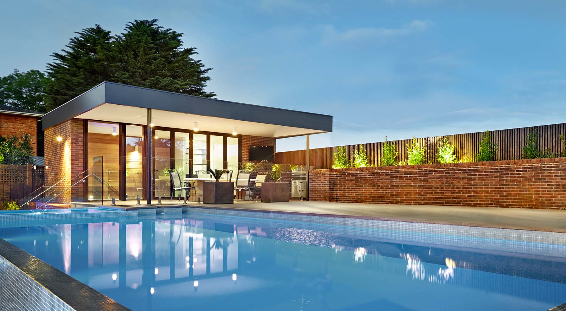 modern pool house design flat roof with red brick walls lots of glass tiled pool