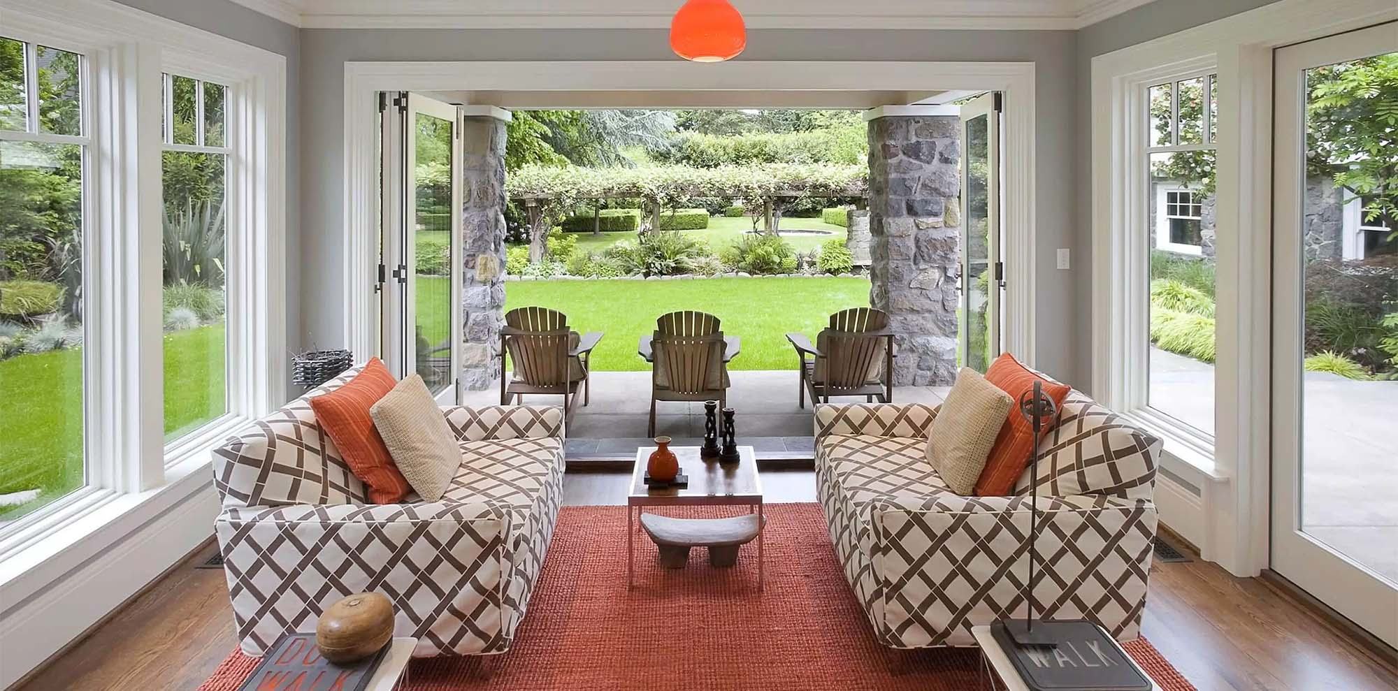 sunroom builder monmouth county NJ stunning sunroom with red area rug - Gambrick