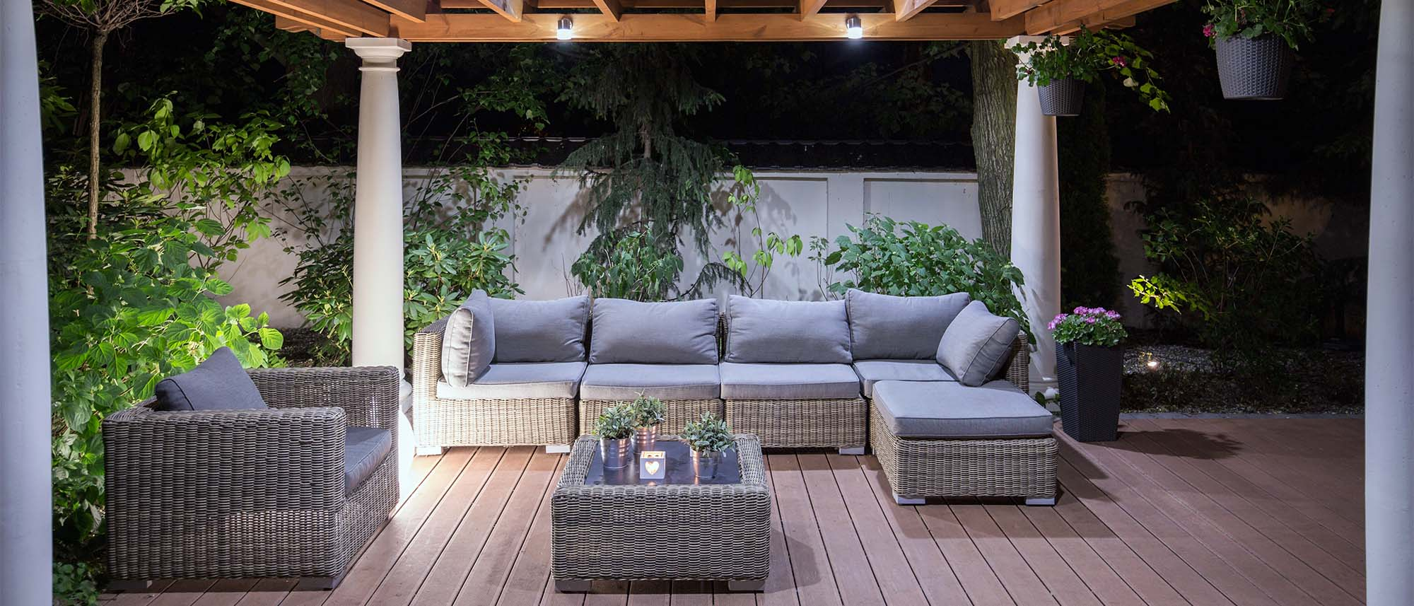custom trex deck with pergola and lighting gray wicker furniture