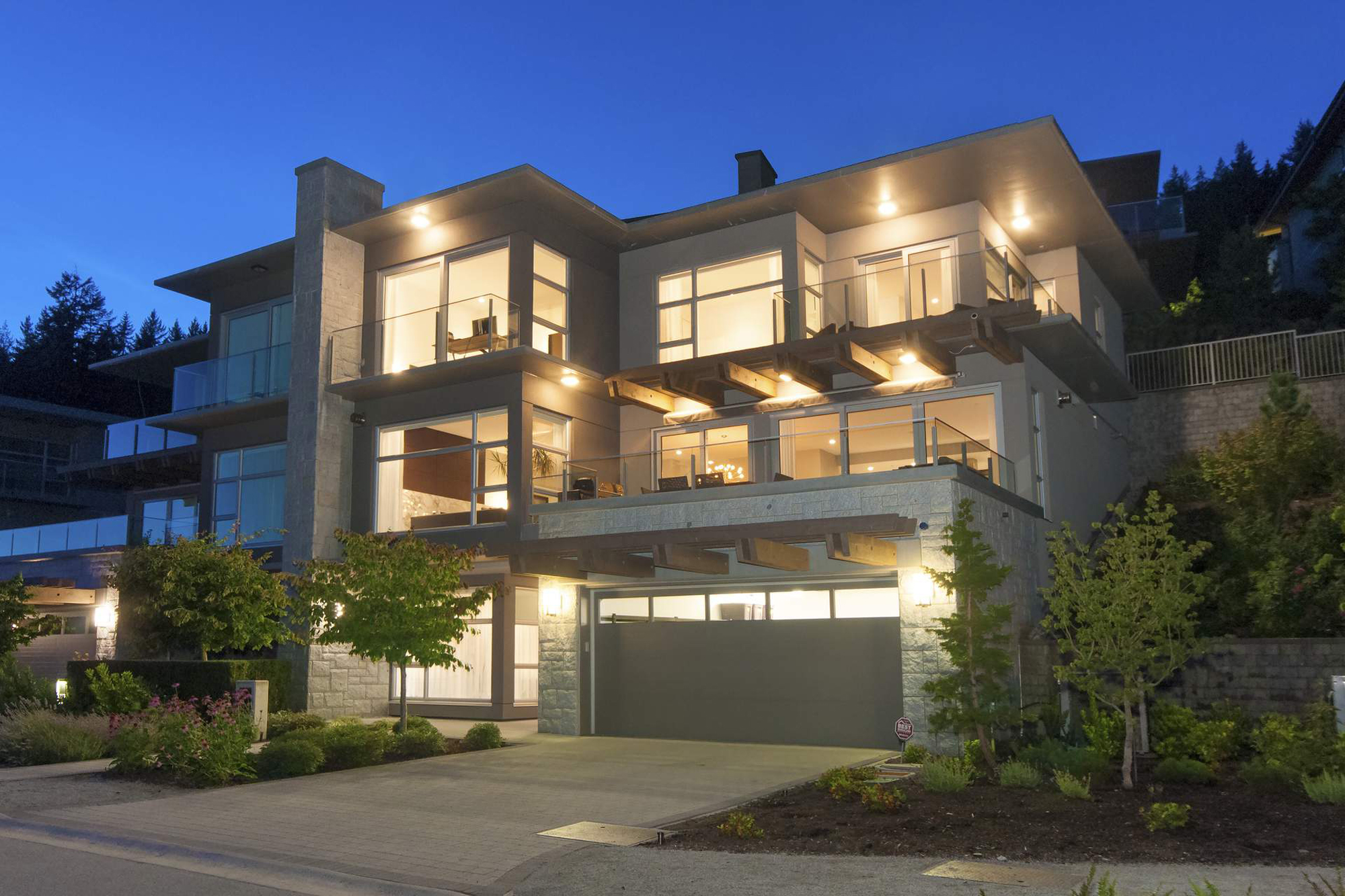 3 story modern home flat roof lots of windows balconys glass railings