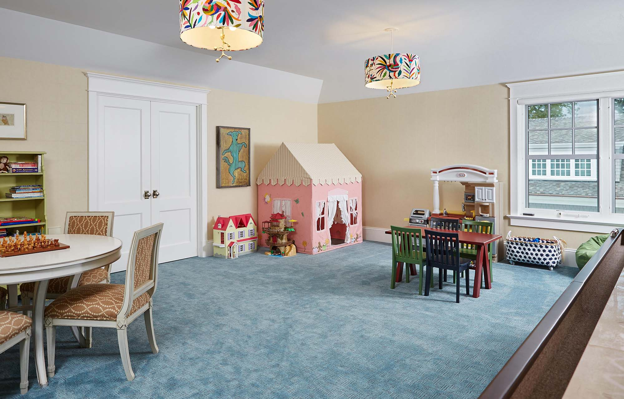 childrens play room tan walls white ceiling and blue carpeting custom craftsmen trim work