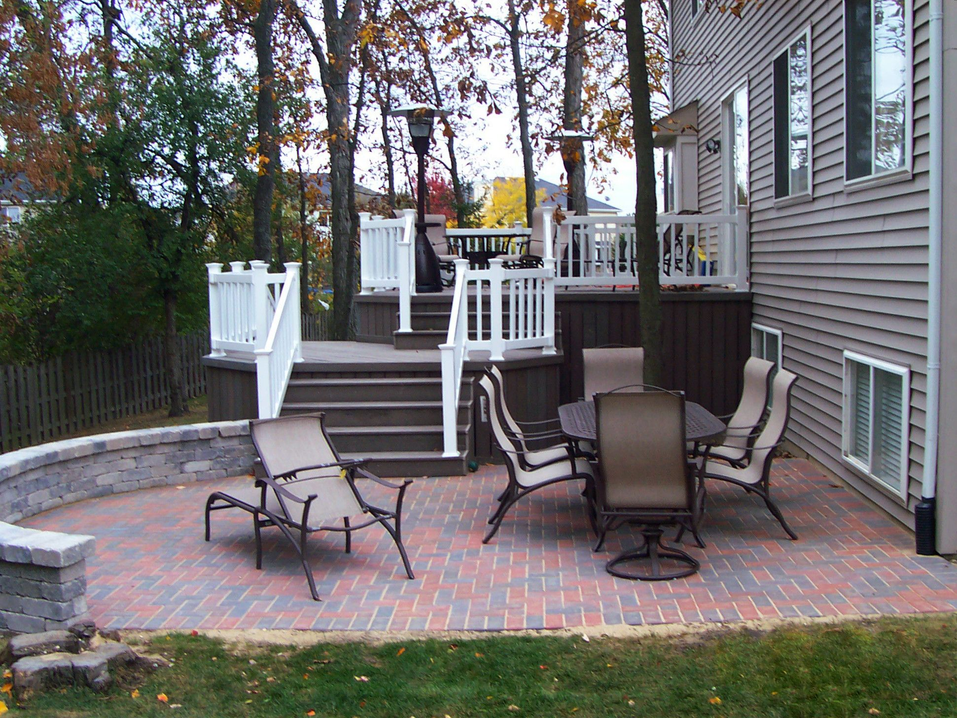 Ocean County NJ Multi level trex deck with brick paver patio and retaining wall