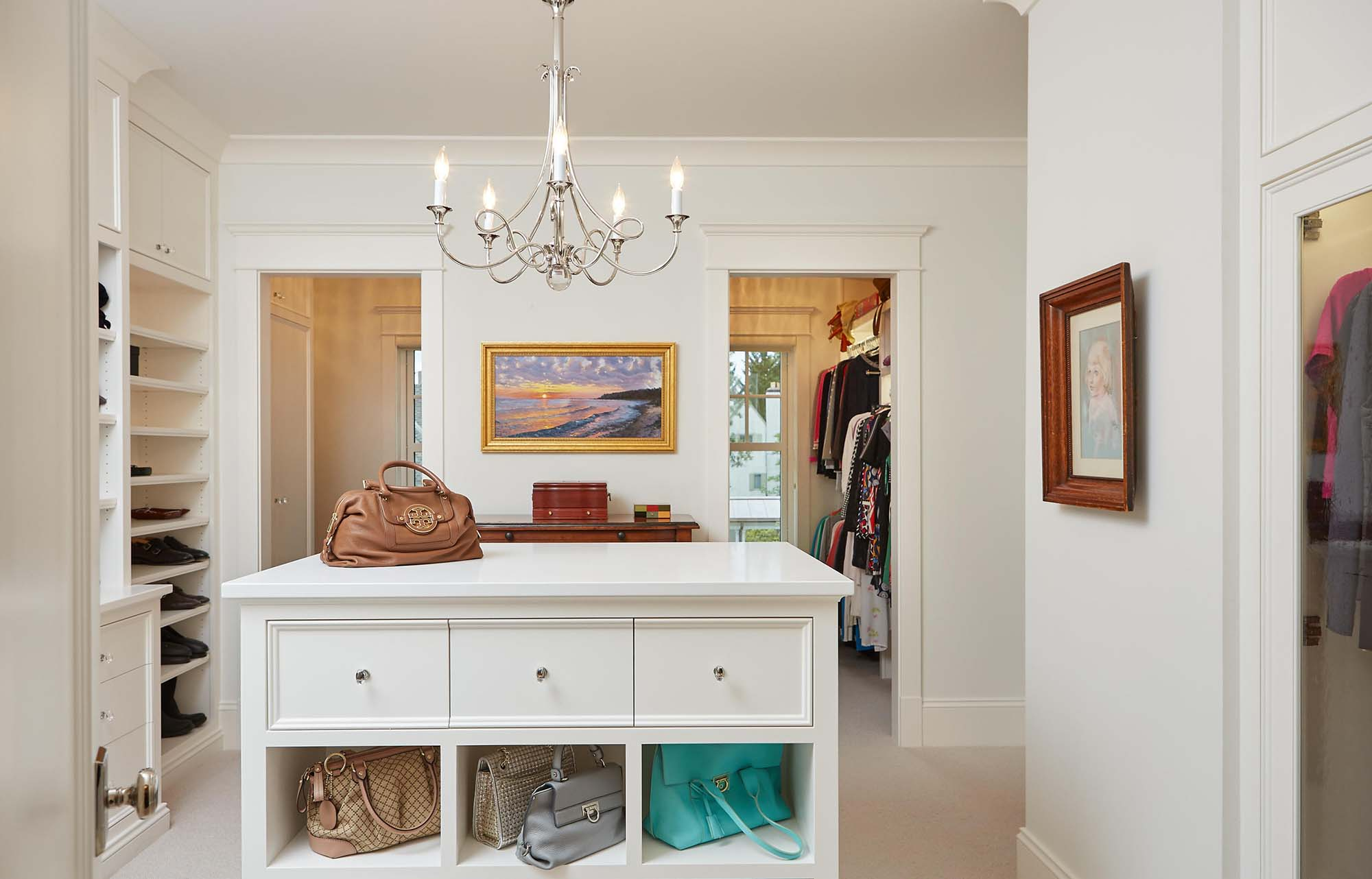 walk in closet with built in shelves folding island table all white closet chandelier