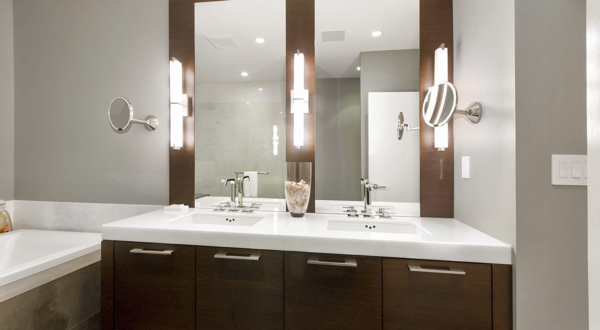 modern double sinks, brown wood vanity with white granite top gray walls