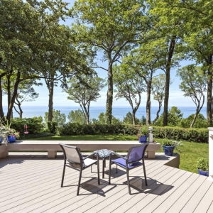 New Jersey Ocean Front Gray Azek Composite deck with built in benches white rails blue patio furniture