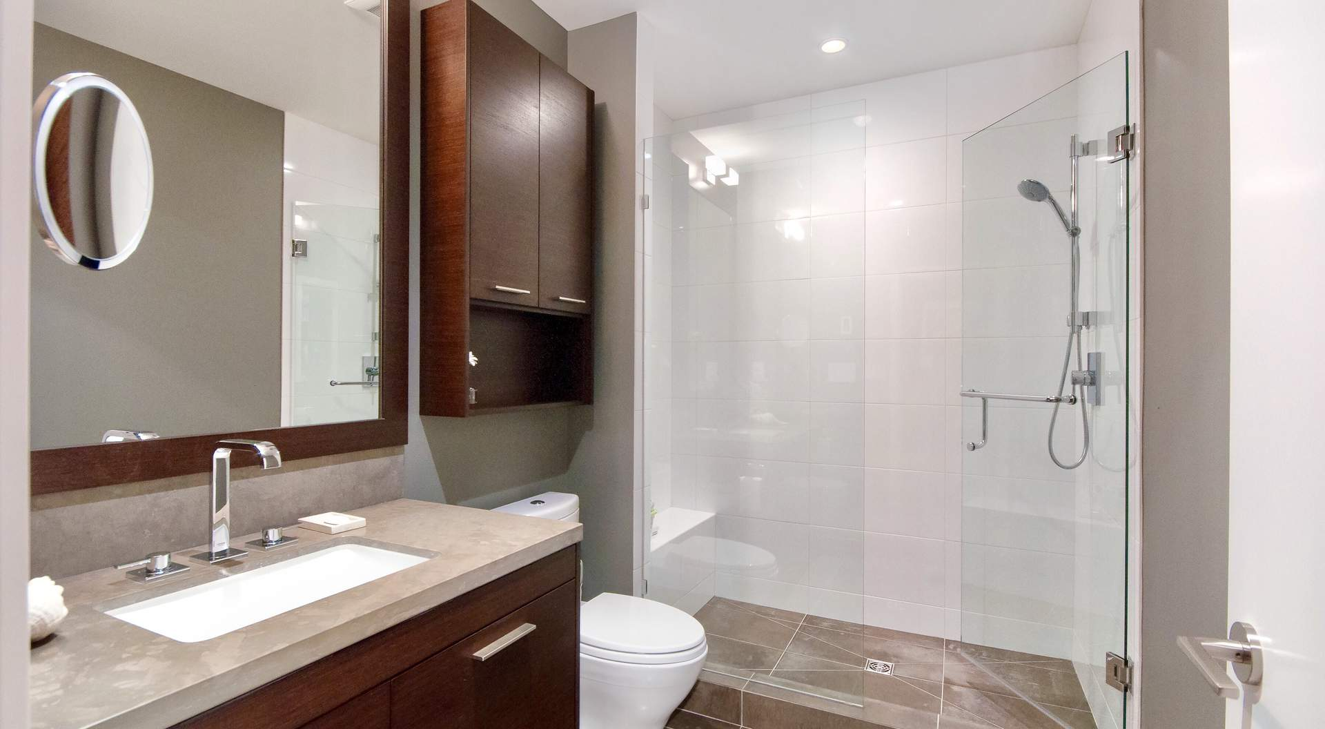 modern bathroom, wood cabinets with tan granite top, stand up shower with glass