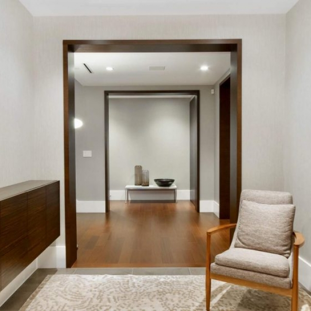 modern entry, floating wood cabinets, gray tile, artwork, wood furniture, modern minimalist wood trim