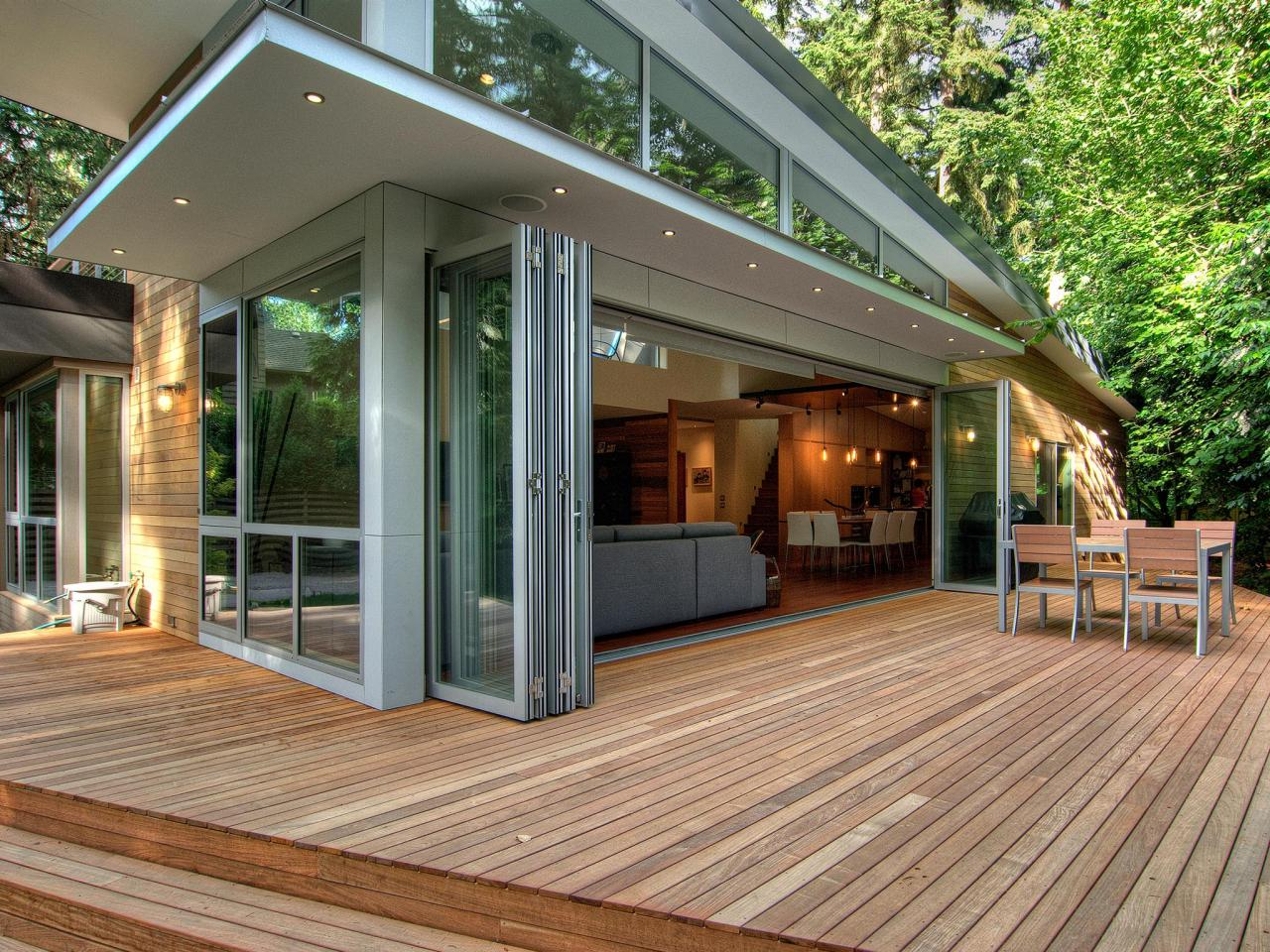 NJ Modern Real wood deck with folding glass doors on a contemporary home