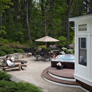 Round Monmouth County New Jersey deck builder Trex deck with jacuzzi Azek stone retaining wall paver patio