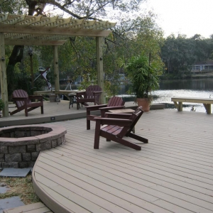 NJ Shore custom Lakefront Trex deck with curved design, Wood arbor, wood furniture, built in benches