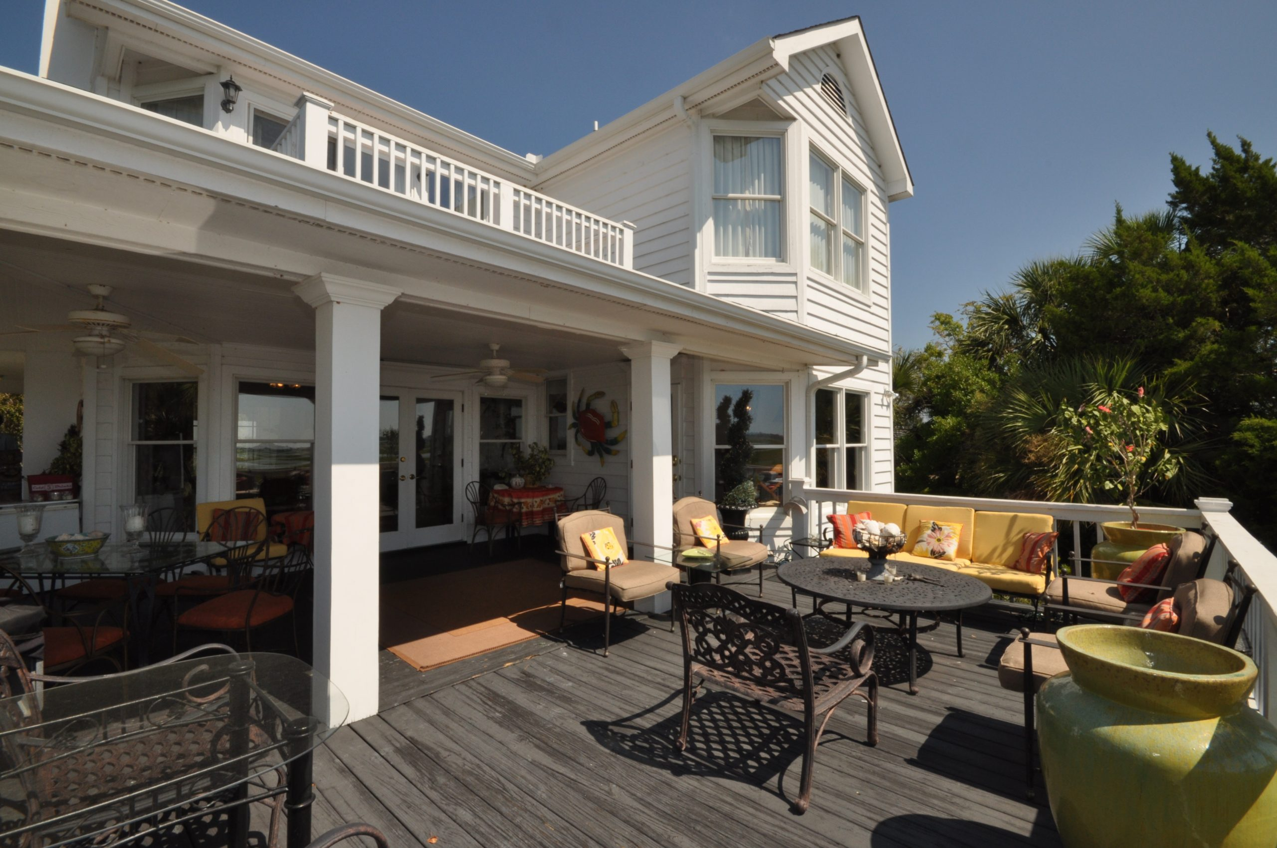 Monmouth County NJ Custom wood deck with white railings, colorful pillows, covered porch