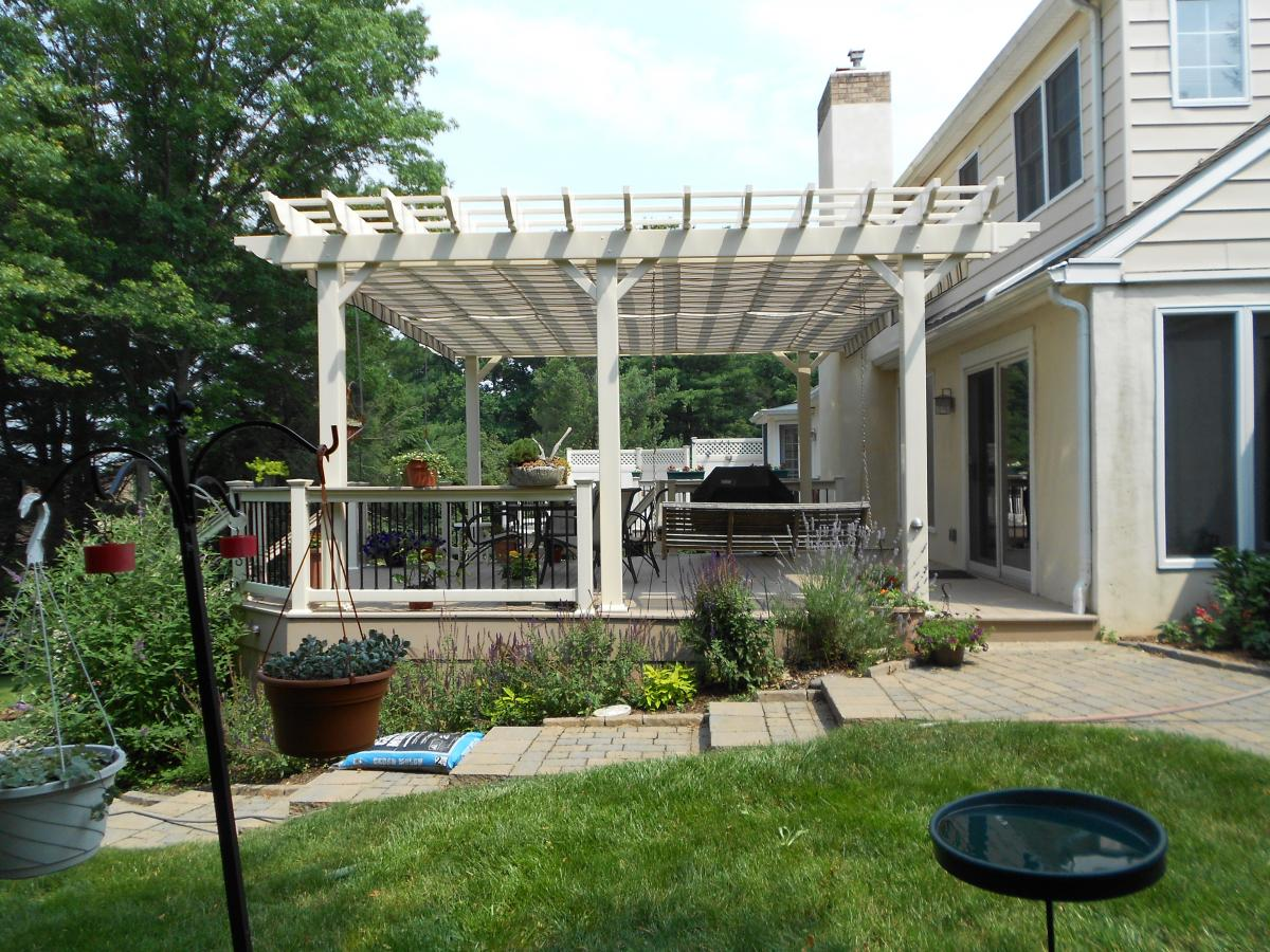 Ocean County NJ Trex deck with white pergola paver patio