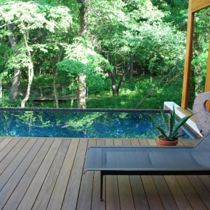 NJ deck company Ipe poolside deck, modern rectangle pool with travertine bullnose, contemporary home