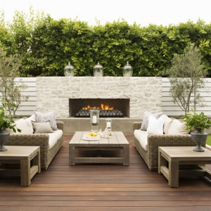 Modern NJ Ipe deck design with wood furniture, real white brick outdoor fireplace, wicker furniture