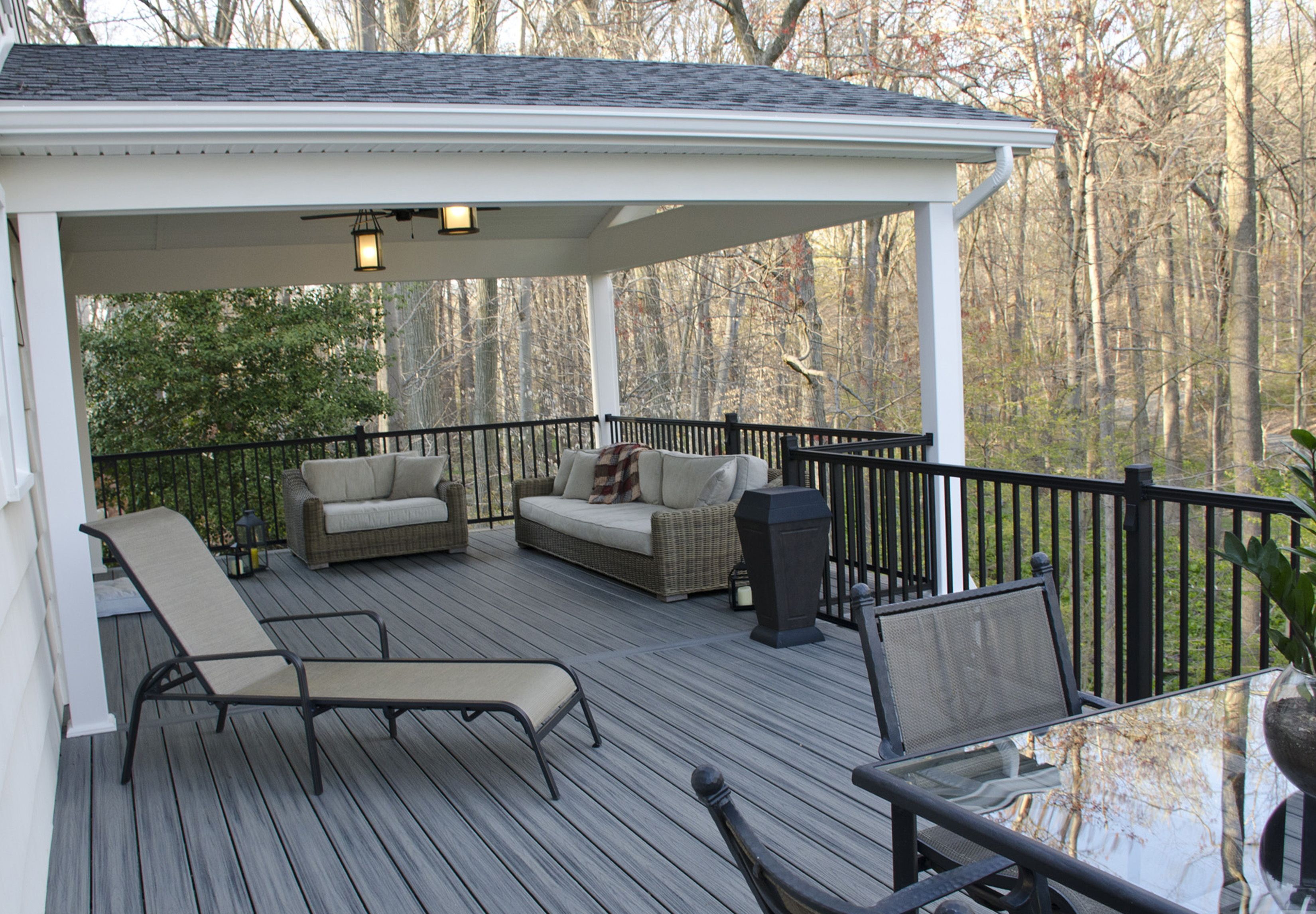 NJ deck builder Custom 2nd floor gray Fiberon deck with overhang roof black metal railings