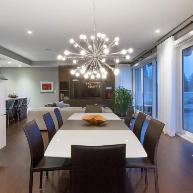 Modern home dining room, modern chandelier, white rectangle dining room table, leather chairs