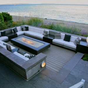 Jersey Shore deck builder gray oceanfront deck with gray paver patio white cushions concrete built in benches