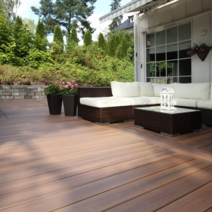 NJ Timbertech decking with Block retaining wall, wicker patio furnite with white cushions