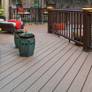 NJ deck builder custom Timbertech deck with brown railings brown wicker furniture Post deck lighting