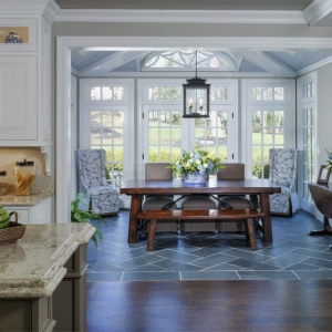 blue and white themed sunroom with french doors and blue bead board ceiling