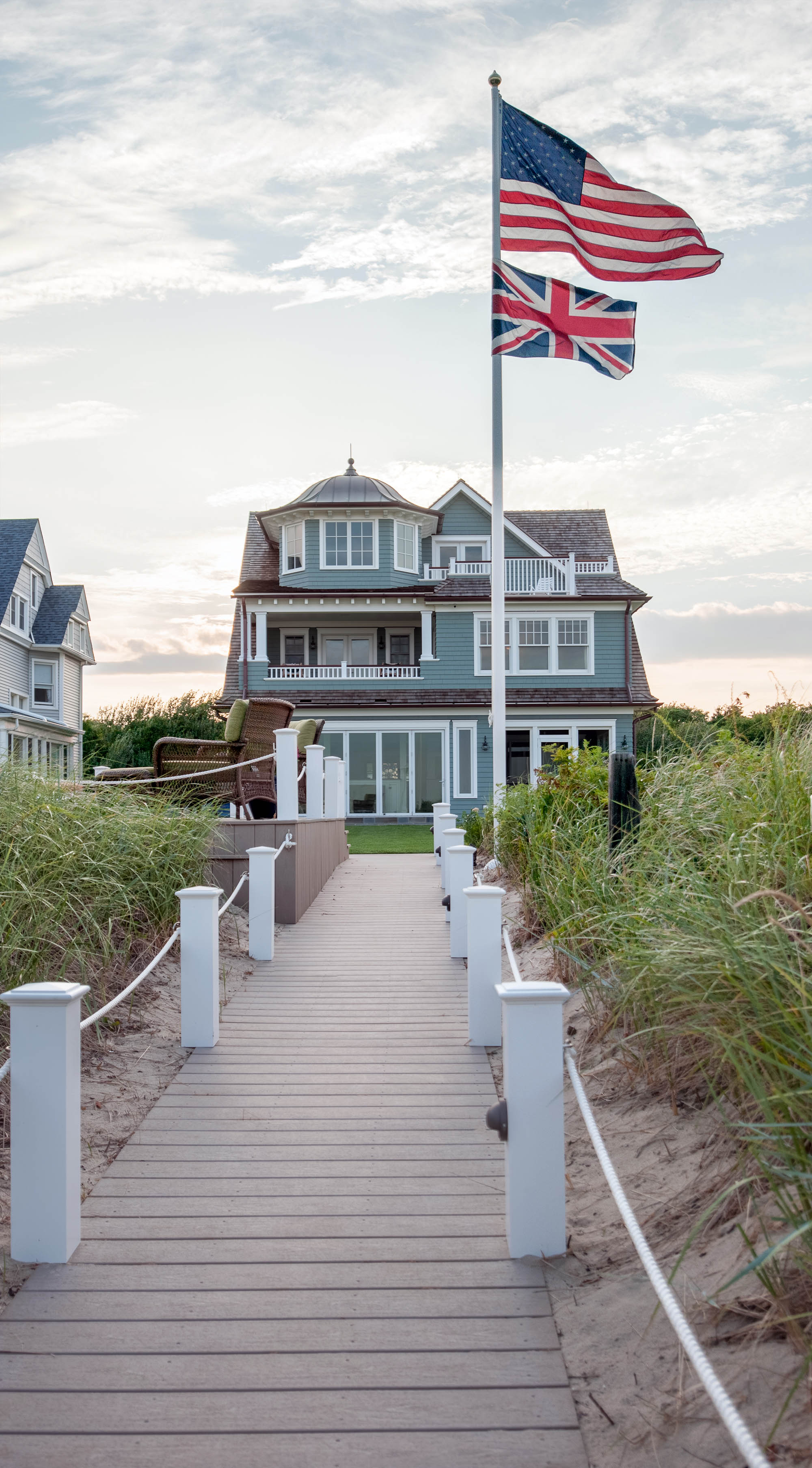 green house color schemes - beautiful NJ ocean front beach house with green siding and wood boardwalk