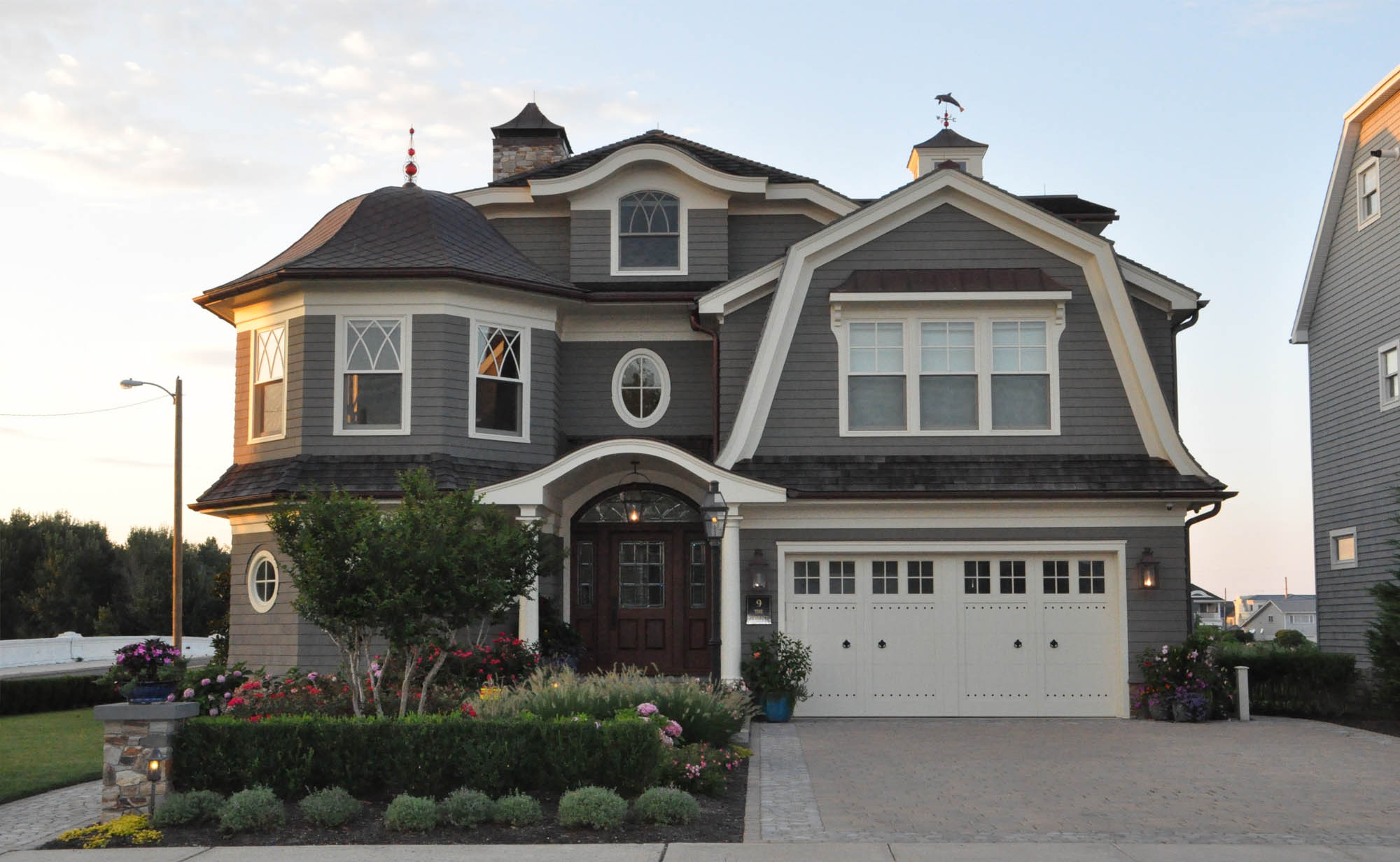 gray green house color schemes with dark brown door and copper gutters - Gambrick