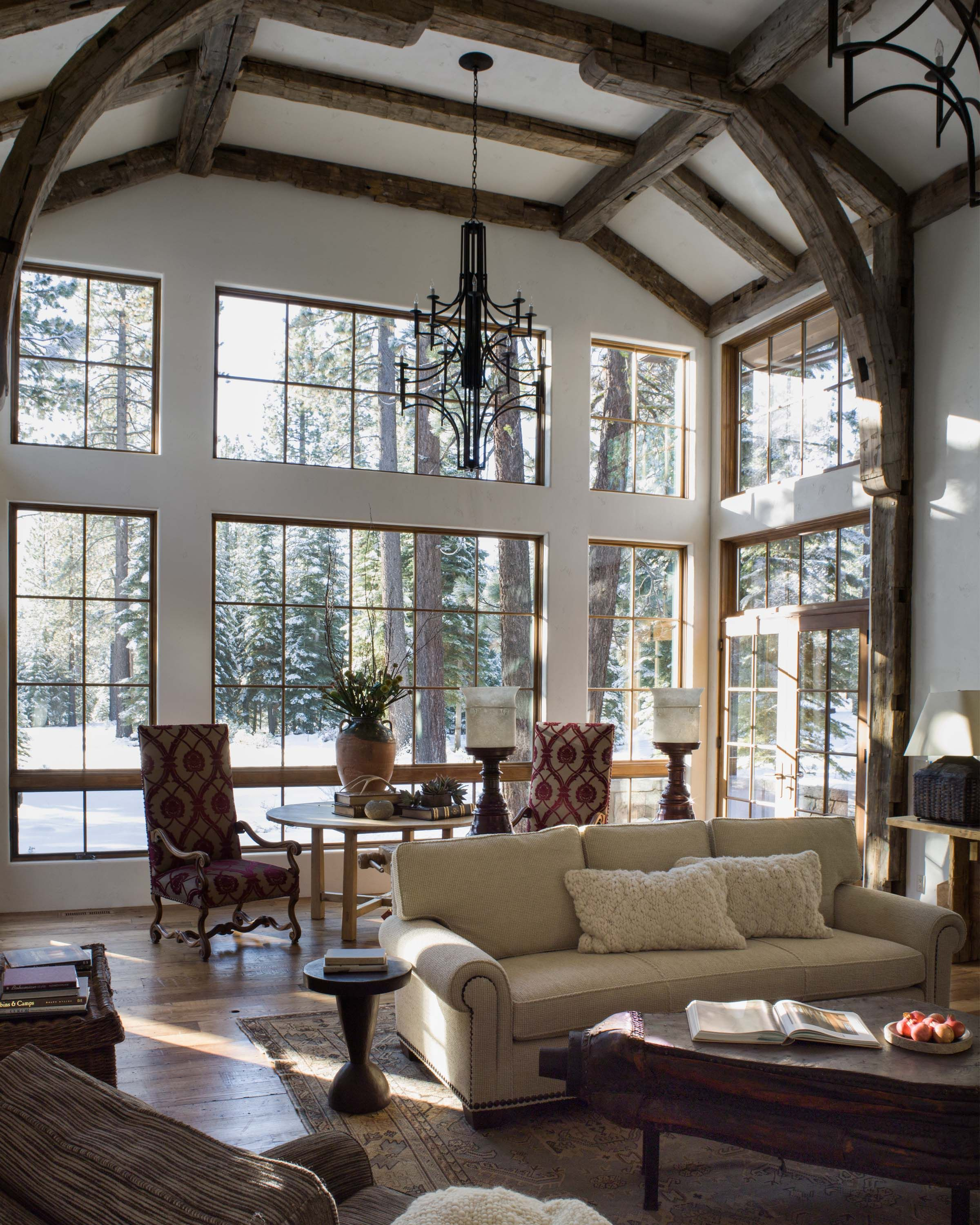 sunroom with glass walls and reclaimed timber beams