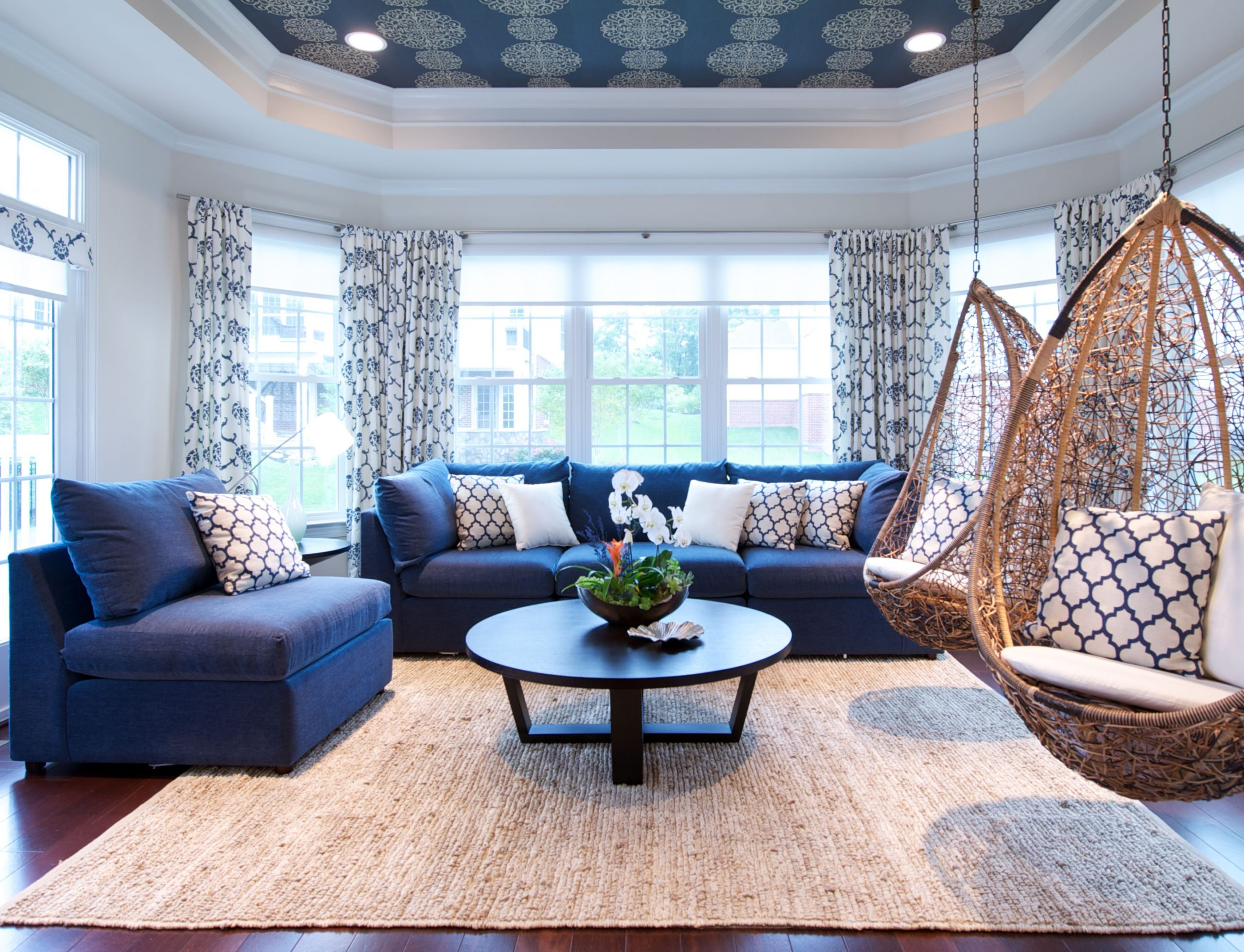 blue and white NJ sunroom with custom ceiling trim hanging sunroom chairs