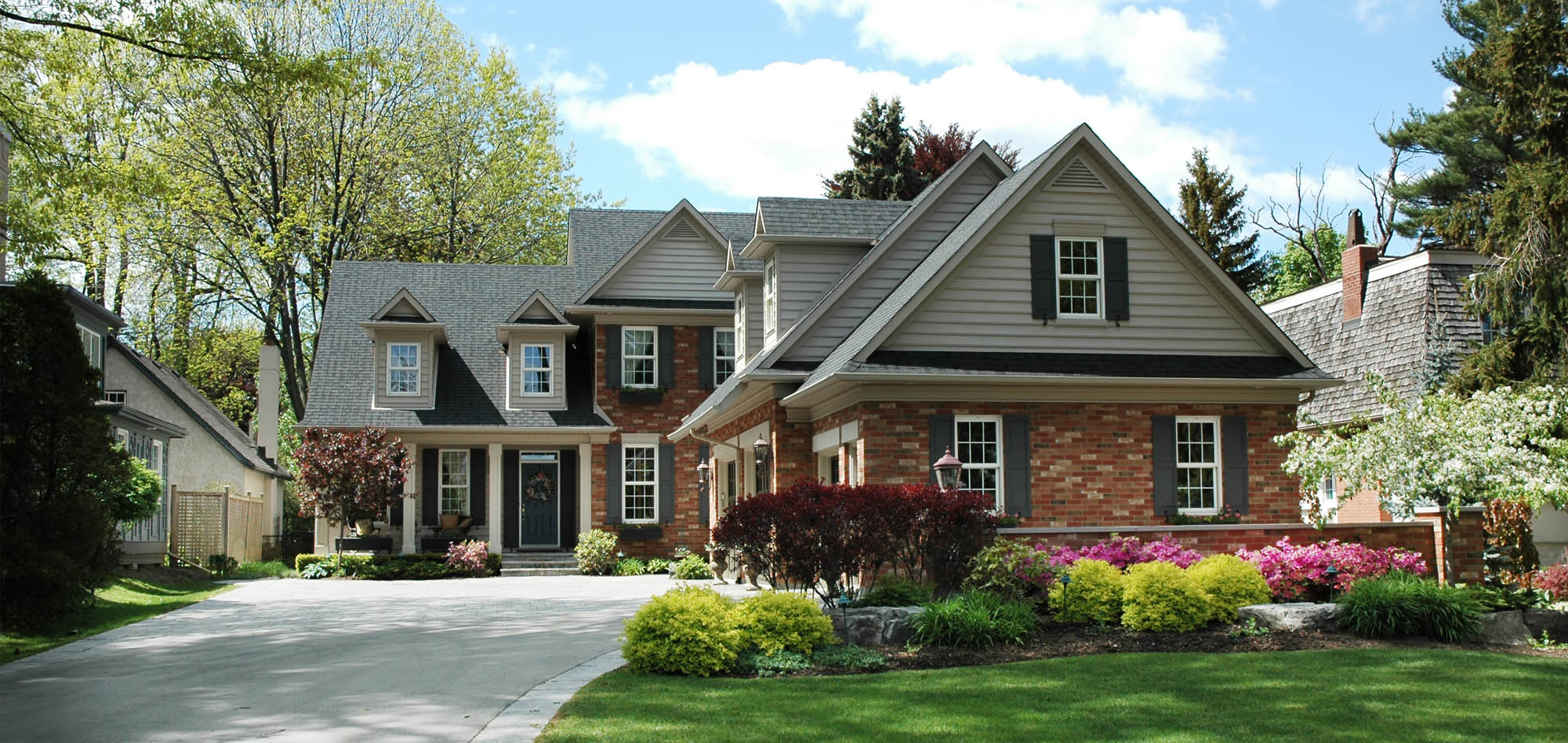 green house color ideas - green siding with brick dark green shutters