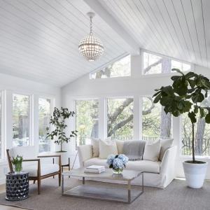 sunroom builder NJ all white sunroom vaulted ceilings gray wood floors all white trim white furniture