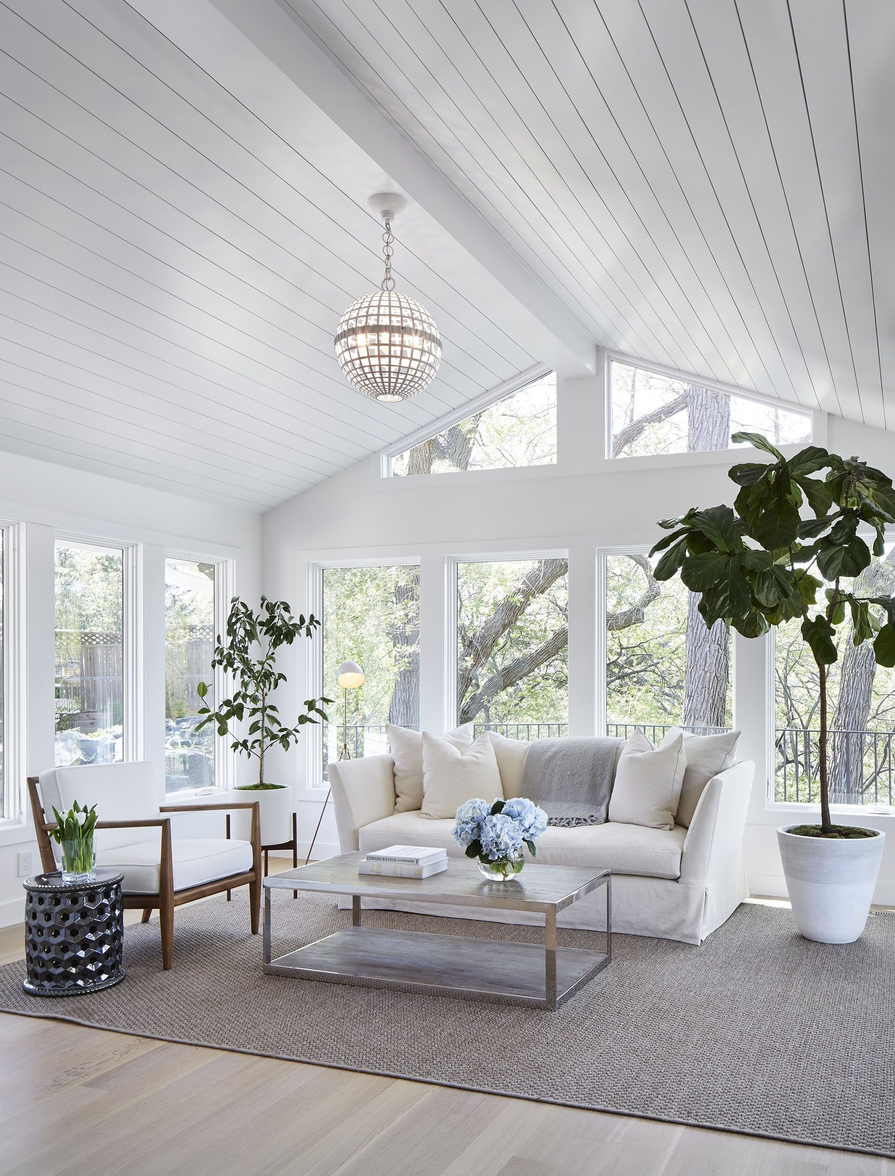 sunroom builder NJ all white sunroom vaulted ceilings gray wood floors all white trim white furniture