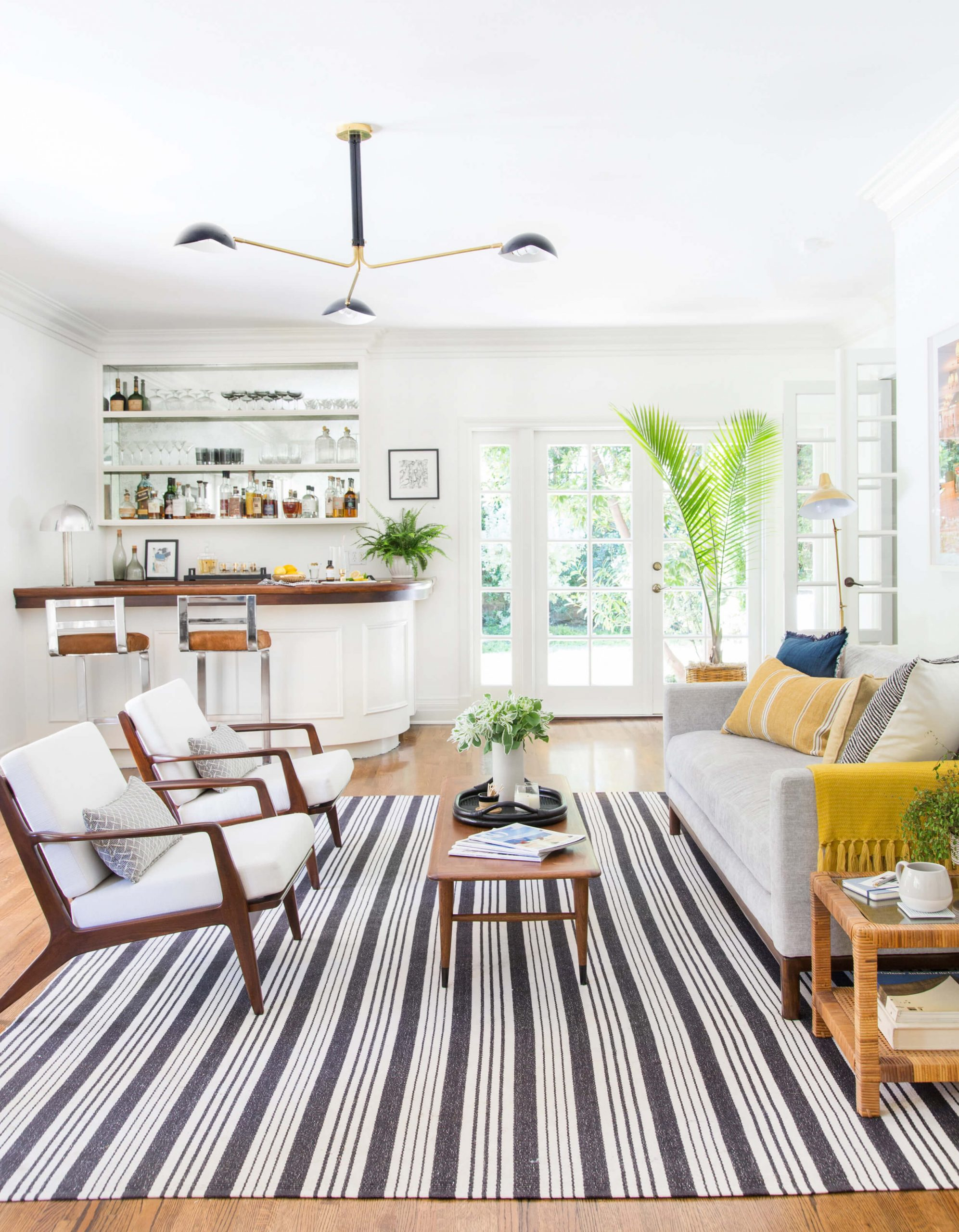 traditional white sunroom with wood floors and sunroom bar crown molding bright
