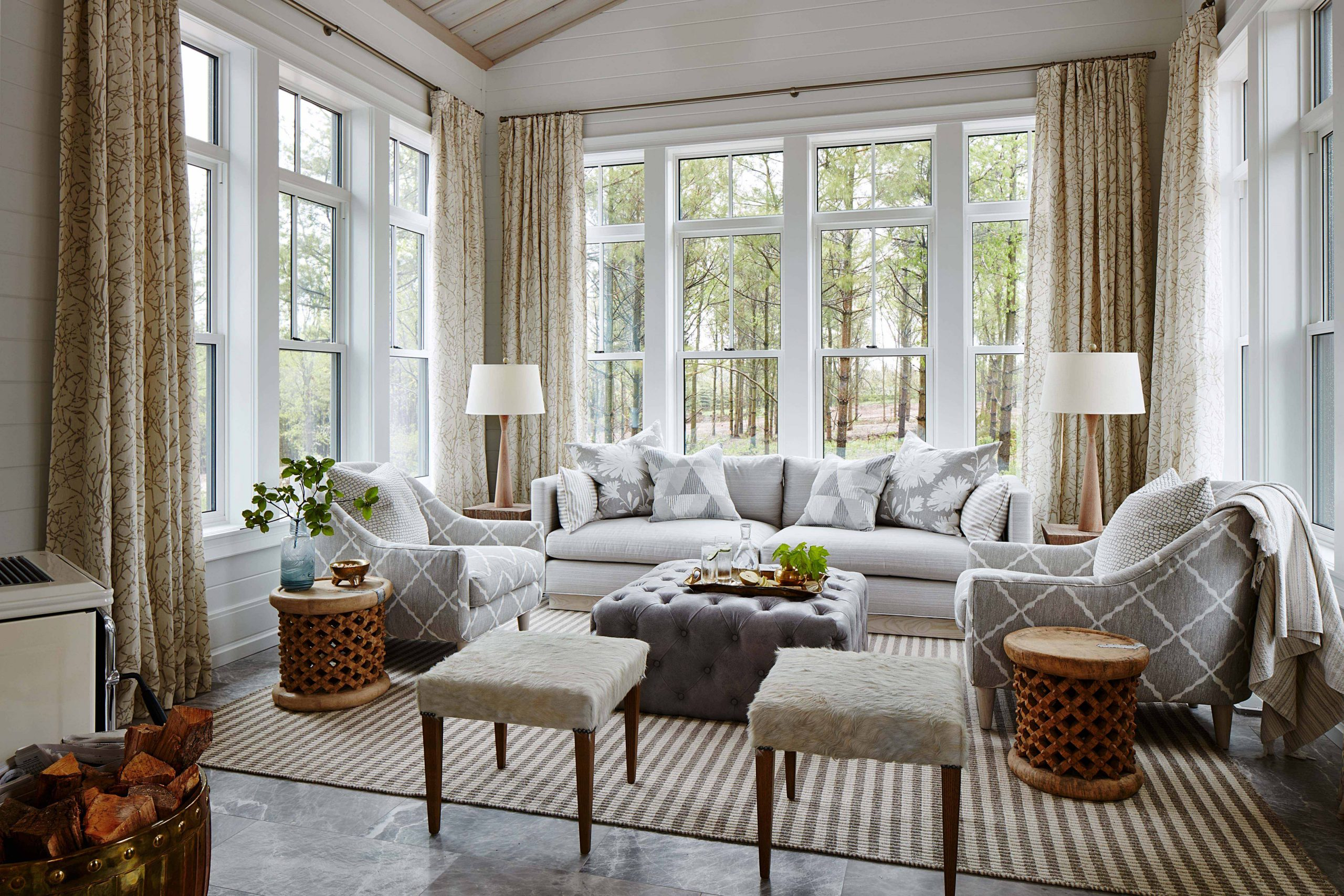 sunroom with vaulte ceilings bead board ship lap neutral colors and gray